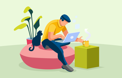 A freelancer with his laptop and cat working from home.
