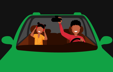 People in a car listening to music from Spotify.