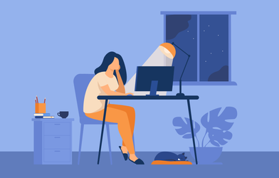 A woman working from home at night.