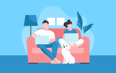 Couple with laptops working from home with their dog.